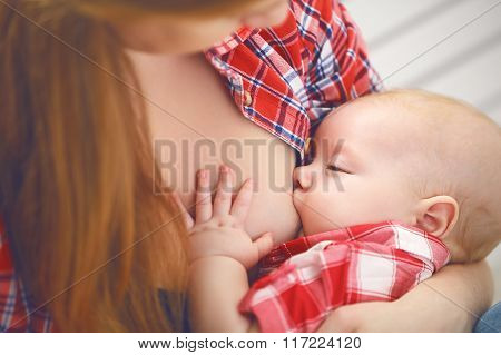Breastfeeding. Mother Breast Feeding Baby