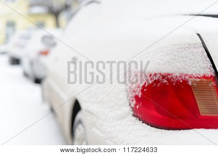 The Red Lamp Of The Car In Snowy Winter.
