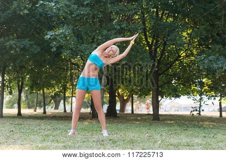 Young Woman  Doing Sports Exercises In The Park