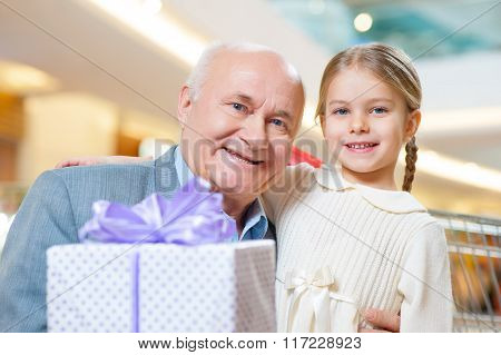 Close-up shot of old grandfather with adorable grandkid