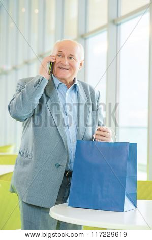 Man expecting to meet somebody and present something.