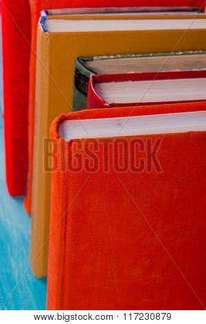 Composition with old vintage colorful hardback books, diary