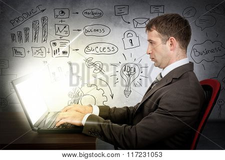 Businessman working on glowing laptop