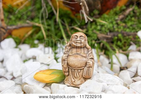 Yellow Flower With Budda Figurine