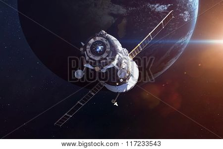 Spacecraft Soyuz orbiting the earth. Elements of this image furnished by NASA