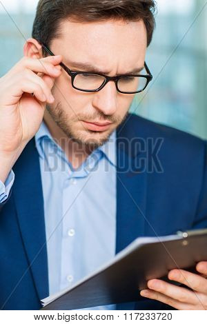 Businessman checking the report.