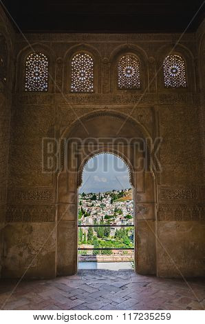 View of city of Granada from an archway in La Alhambra.