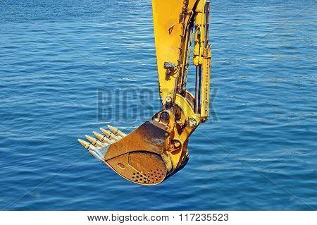 Rusty Bulldozer Scoop Over Water