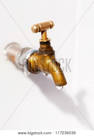 Brass Faucet. As The Drops Of Water.