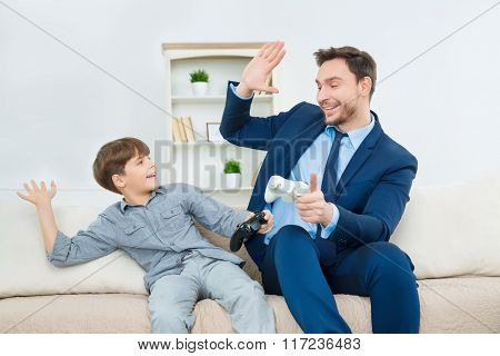 Handsome dad enjoying time with cute son