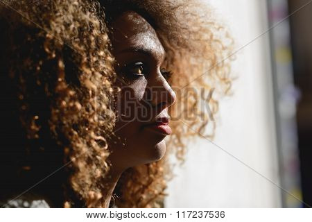 Young black girl with afro hairstyle