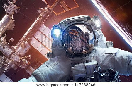 International Space Station with astronaut over the planet Earth. Elements of this image furnished b