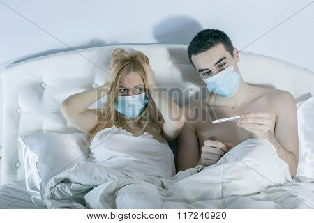 Couple In Bed Suffering Common Cold