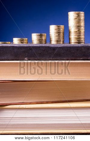 Banking. Go to Bank. Golden columns of coins on green background