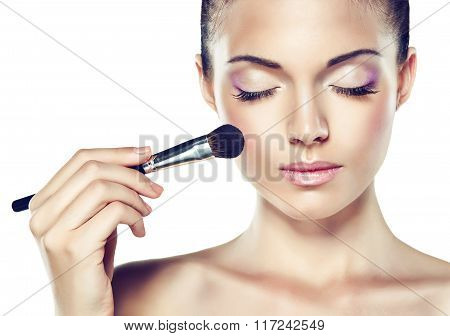Beauty Portrait. Beautiful Spa  girl  with brush for makeup  .  Cosmetics and cosmetology.