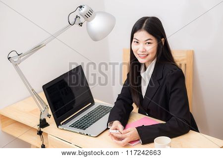 Asian Business Woman With Working Desk In Office