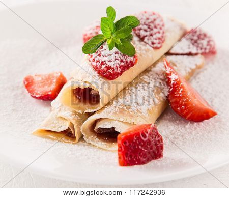 Tasty pancakes with fresh berries, close-up.