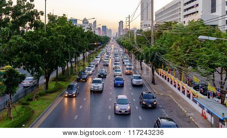 Bangkok Thailand - December 29 2015: Traffic moves slowly along a busy road in Bangkok Thailand. Annually an estimated 150000 new cars join the already heavily congested streets of Bangkok.
