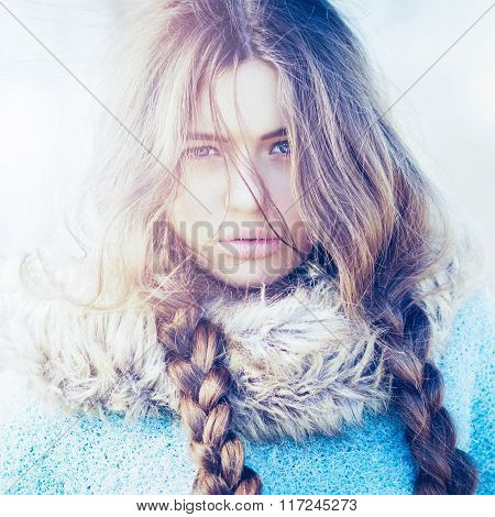 Gorgeous young woman with long braided hair