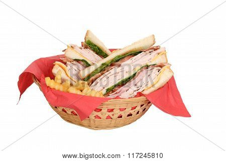 chicken club sandwich in wood basket