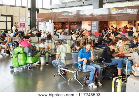 ROME, ITALY - AUGUST 16, 2015: people in Fiumicino Airport. Fiumicino - Leonardo da Vinci International Airport is a major international airport in Rome, Italy