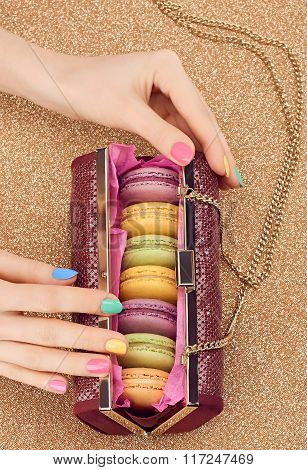 Macarons, fashion handbag, woman hand,gold.Vintage