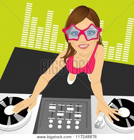 female disc jockey mixing music using her turntables