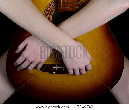 Girl Hugging An Acoustic Guitar