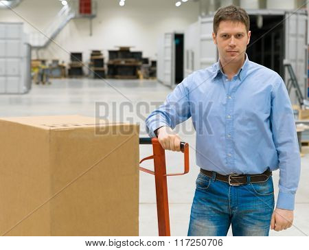 Male Worker With Boxes At Warehouse.