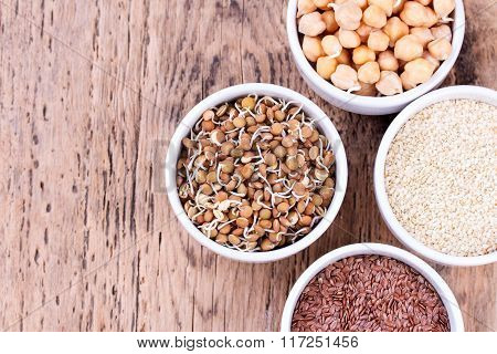 Bowls Of Various Legumes And Seeds. Lentils, Sesame Seeds, Pistachio Nuts, Flaxseed, Raisins, Peanut