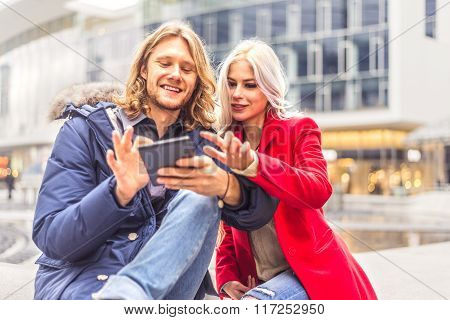 Couple With Tablet Outdoors