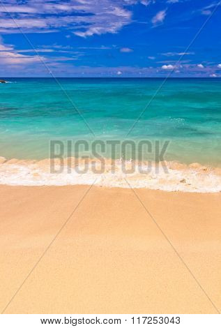 Waves on tropical beach - abstract nature background