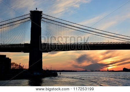 View of the sunset at New York City Brooklyn bridge