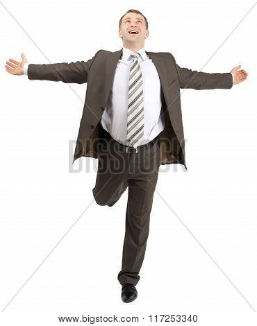 Happy businessman running forward