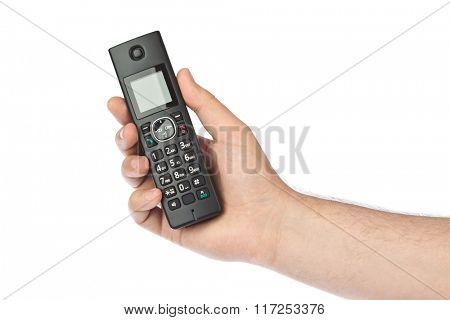 Hand with wireless radio telephone isolated on white background