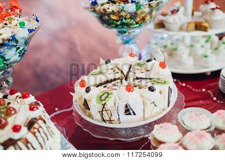 cake decorated with whipped cream and cherries