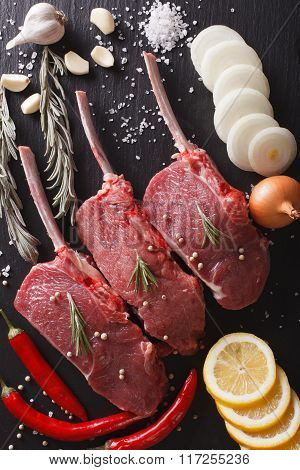 Raw Beef Steak With Spices On A Stone Table Closeup. Vertical Top View