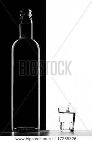 Transparent bottle and Glass on black and white background