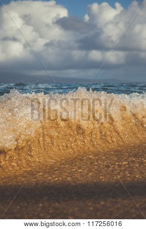 Sandy Waves Crashing on the Beach in Maui