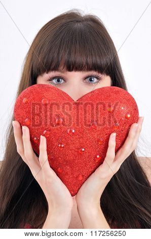 Close-up Portrait Of Attractive Young Girl Keeping Big Red Heart In Front Of Her Face