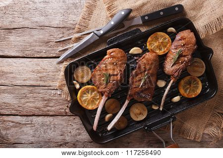 Beef Steak With Lemon On A Grill Pan. Horizontal Top View