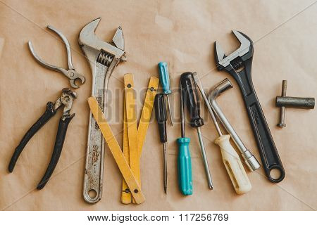 Set Of Hand Tools On Craft Paper Background