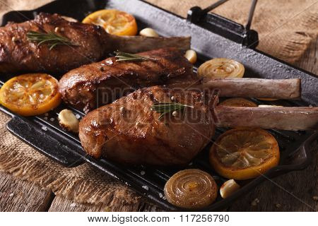 Beef Steak With Spices On The Grill Pan Close-up On The Table. Horizontal
