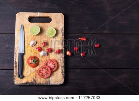 Ingredients And Knife On Dark Background