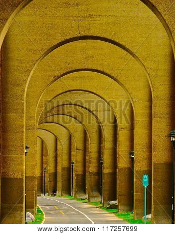 Under a railroad bridge