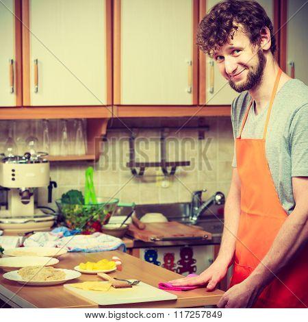 Man Preparing Food Cooking In Kitchen.