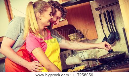 Couple Woman And Man Frying Chicken Cutlet.