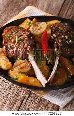 Beef Steak With Chili And A Side Dish Of Potatoes Close Up. Vertical