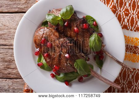 Beef Steak With Pomegranate Closeup On A Plate. Horizontal Top View