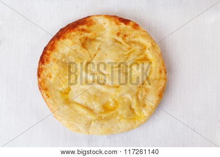khachapuri round top on a white background golden mouthwatering delicious